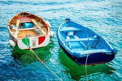 Two old wooden fishing boats in turquoise water Royalty Free Stock Photos