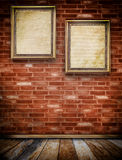Two old wooden frames on bricks wall. Royalty Free Stock Photography