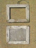 Two old wooden picture frame on the  burlap. Royalty Free Stock Image