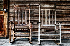 Two old wooden rocking chairs Royalty Free Stock Photos
