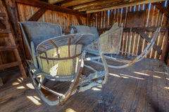Two old wooden vintage sleighs or sleds in an old restored barn Stock Image