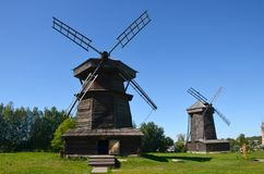 Two old wooden windmills in the museum of wooden architecture on a sunny summer day in the city of Suzdal, Russia royalty free stock photography