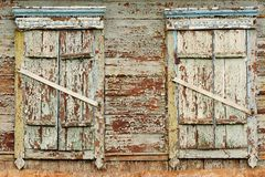 Two old wooden windows with closed shutters Stock Photos
