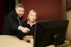 Two older business people working in office Royalty Free Stock Image