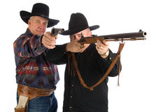 Two older cowboys. Two older cowboys holding up and aiming their guns. Isolated on white Royalty Free Stock Image