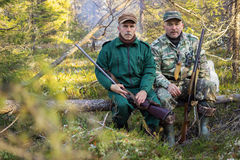 Two older hunters rest Stock Images