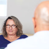 Two older persons talking royalty free stock photos