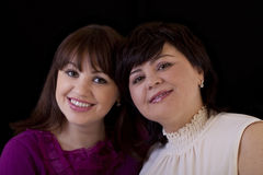 Two older sisters portrait heads together smiling Stock Photography