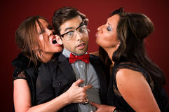 Two older women with a shy young man. Two aggressive cougar women corner a shy young man Stock Image