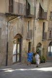 Two older women walking in village of Solsona, Cataluna, Spain Stock Images