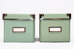 Two olive green home storage boxes Stock Image