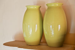 Two olive green vases cottage shelf Royalty Free Stock Photography