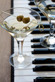 Two olive martini cocktails stock photos