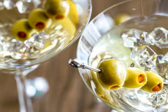 Two olive martini cocktails royalty free stock photography