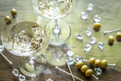 Two olive martini cocktails Stock Images