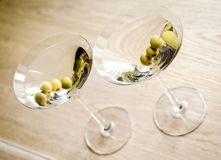 Two olive martini cocktails. The top view Stock Images