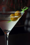 Two olives in a martini glass Stock Images