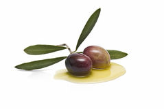 Two olives on olive oil Royalty Free Stock Image