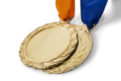 Two olympic gold medals Royalty Free Stock Images