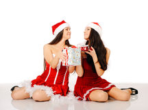 Two oman in Christmas clothes Royalty Free Stock Image