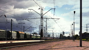 Two oncoming freight trains. Freight transport - two oncoming freight trains. The sky with storm clouds stock footage