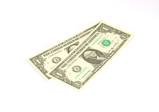 Two one dollar bills at an angle. Against a white background Stock Photography