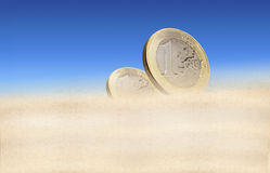 Two one euro coins in a desert Royalty Free Stock Photo