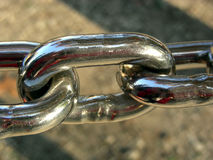 Two and One Half Links. One full and two partial links of a chain fence Stock Images
