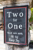 Two for One. A Two for One offer on a chalk board Stock Photos