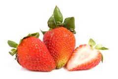 Two and one sliced isolated strawberries Stock Images