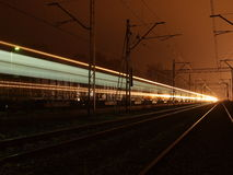 Two trains in one image. Trains at night or photographic experiment with a long exposure Royalty Free Stock Photo