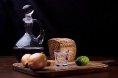 Two onions, cucumber and rye bread Royalty Free Stock Images