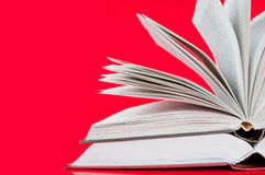 Two open books. On red background Stock Photo