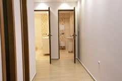 Two open doors to big modern bathroom and toilet. Home interior.  royalty free stock photos