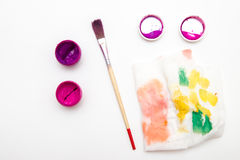 Two open  gouache colors with brush and palette. On white Royalty Free Stock Photos