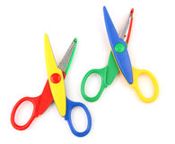 Two open scissors. Two colorful kid's scissors isolated on white Royalty Free Stock Images