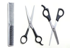 Two open scissors and comb barber isolated Royalty Free Stock Photo