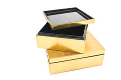 Two opened golden gift boxes Stock Photo
