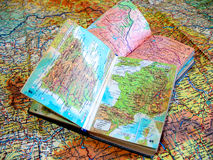 Two opened old atlas book on the spread map Stock Image