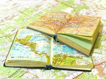 Two opened old atlas book on the spread map Royalty Free Stock Photo