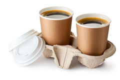 Two opened take-out coffee in holder. Standing on a white Royalty Free Stock Photography