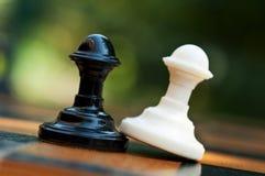 Two opposing pawns Royalty Free Stock Image