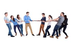 Two opposing teams having a tug of war Royalty Free Stock Photos