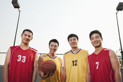 Two opposite basketball teams standing and smiling, Portrait Stock Photography