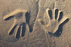 Two opposite handprints. In the sand Royalty Free Stock Photo