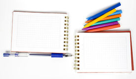 Two opposite notebook. With pen and wax pencils Stock Image