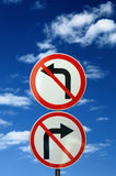 Two Opposite Road Signs Against Blue Sky Royalty Free Stock Photo
