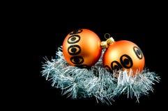 Two orange christmas balls. Isolated on black background stock image