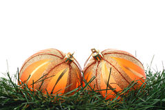 Two orange Christmas baubles on green fir isolated Stock Photography