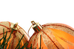 Two orange Christmas baubles isolated on white Royalty Free Stock Photo